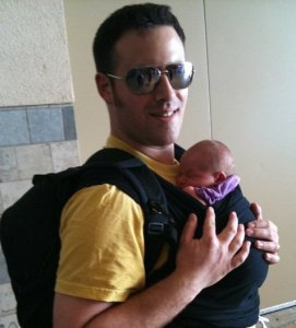 Dad carrying baby